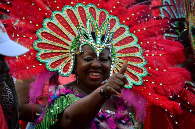 A lady smiles and gestures during the annual Calabar cultural festival in Calabar, Nigeria, December 28, 2015. (Photo by Reuters/Stringer)