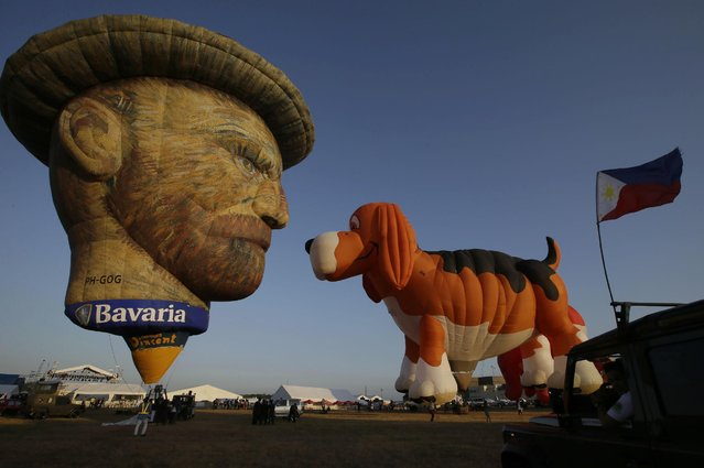 Special-shape hot air balloons known as Vincent van Gogh, left, and Maximus The Beagle Dog, are prepare to take off at the start of the 19th Philippine Hot Air Balloon festival Thursday, February 12, 2015 at Clark Economic Zone, Pampanga province north of Manila, Philippines. (Photo by Bullit Marquez/AP Photo)