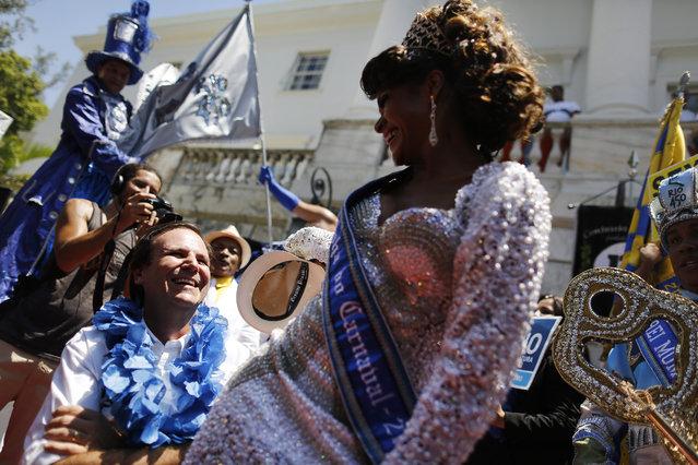 Rio de Janeiro's Mayor Eduardo Paes, left,  dances samba with the Carnival Queen Clara Paixao, at a ceremony marking the official start of Carnival in Rio de Janeiro, Brazil, Friday, February 13, 2015. (Photo by Leo Correa/AP Photo)