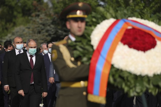Armenian Prime Minister Nikol Pashinyan, second left, attends a memorial service at the monument to the victims of mass killings by Ottoman Turks, to commemorate the 106th anniversary of the massacre, in Yerevan, Armenia, Saturday, April 24, 2021. Armenians marked the anniversary of the death of up to 1.5 million Armenians by Ottoman Turks, an event widely viewed by scholars as genocide, though Turkey refutes the claim. (Photo by Tigran Mehrabyan/PAN Photo via AP Photo)