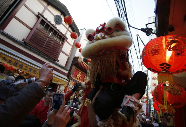 A lion dance is performed in front of a Chinese restaurant during the Chinese Lunar New Year celebrations at Chinatown in Yokohama, south of Tokyo, February 19, 2015. (Photo by Yuya Shino/Reuters)