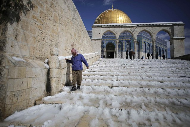 A Palestinian man walks down snow-covered stairs after Friday prayers near the Dome of the Rock on the compound known to Muslims as Noble Sanctuary and to Jews as Temple Mount, in Jerusalem's Old City February 20, 2015. (Photo by Ammar Awad/Reuters)